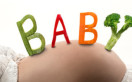 Baby vegetable word on pregnant belly